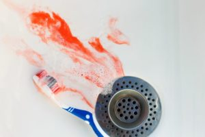 blood in sink by toothbrush