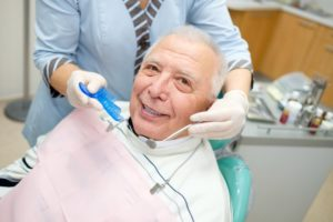 older man smiling with dental implants in Houston